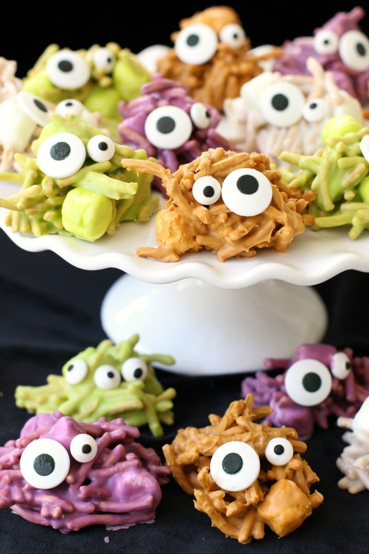 Haunted Haystacks are made from butterscotch chips, peanut butter and marshmallows. Melted and shaped with candy eyeballs for a festive Halloween treat.