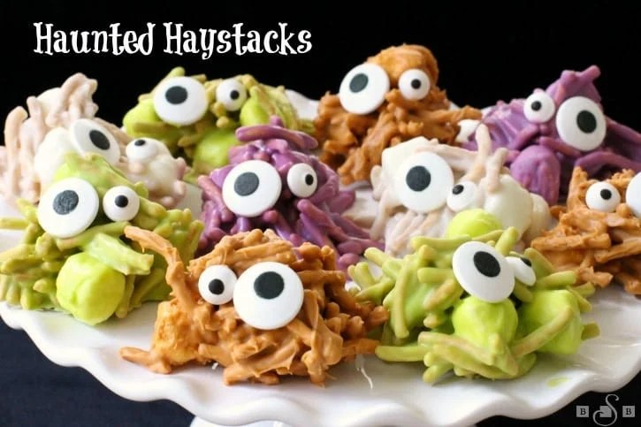 Haunted Haystacks are made from butterscotch chips, peanut butter and marshmallows. Melted and shaped Butterscotch Haystacks with candy eyeballs for a festive Halloween treat.