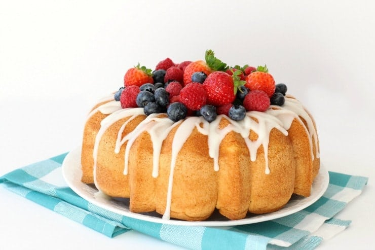 Homemade Vanilla Cake is the easiest homemade cake recipe ever! Just 4 ingredients you likely already have on hand: sugar, eggs, flour and vanilla. Simple Cake recipe that's a cross between angel food cake and sponge cake.