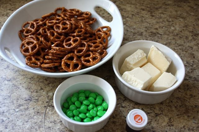 Pumpkin Pretzels made with just a few ingredients & are perfectly festive for Halloween! Tips for melting chocolate and the BEST tool to use.