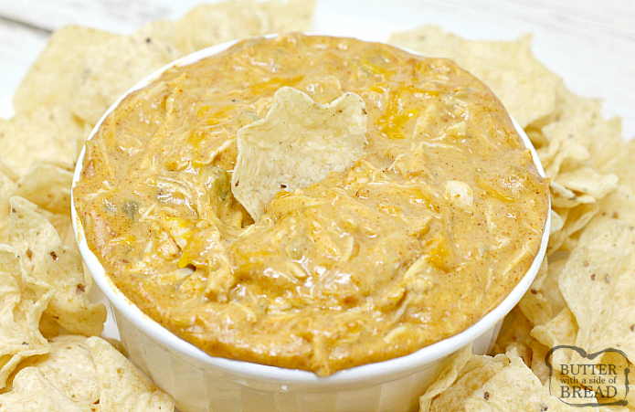 Cheesy Chicken Enchilada Dip is loaded with cheese, chicken, and a little bit of spice too! Add some chips and this is the perfect easy appetizer for a party!