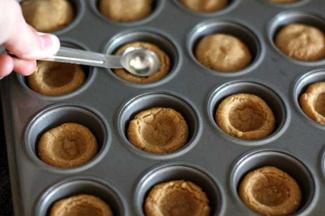 Peanut Butter Fudge Cups are the perfect dessert, starting with a peanut butter cookie base, and topped off with a delectable fudge filling!