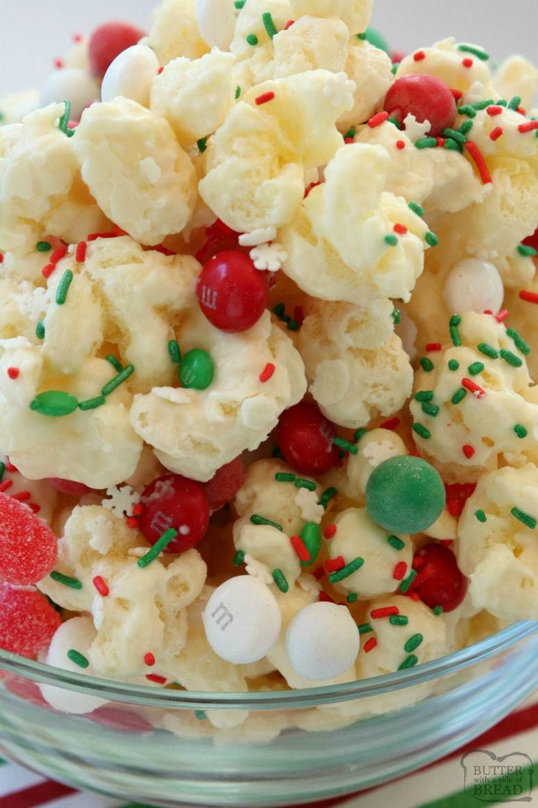Christmas Candy Puffcorn made easy in minutes with almond bark coating buttery puffcorn & topped with festive holiday candies and sprinkles!