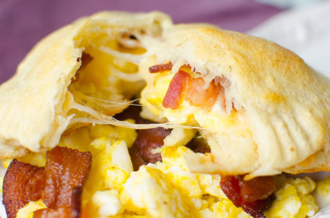 Canned crescent roll dough baked with scrambled eggs, bacon and cheese inside to make a convenient breakfast.