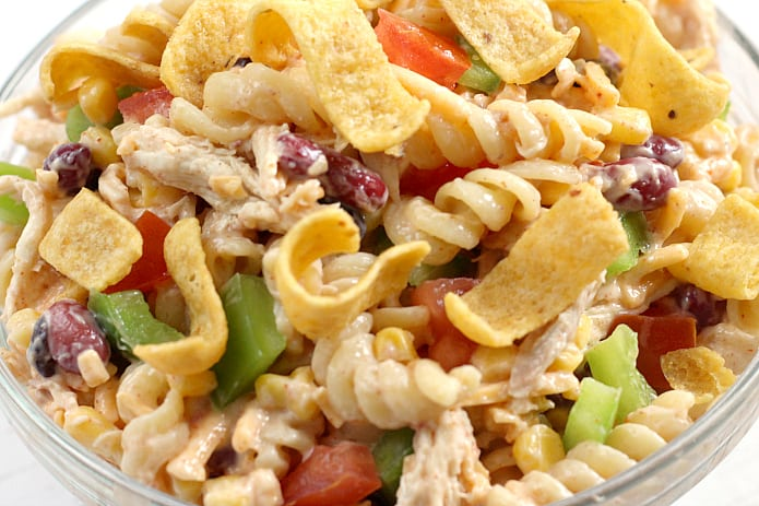 Fiesta Ranch Chicken Pasta Salad - full of beans, corn, cheese, tomatoes and chicken tossed with a delicious southwestern Ranch dressing!