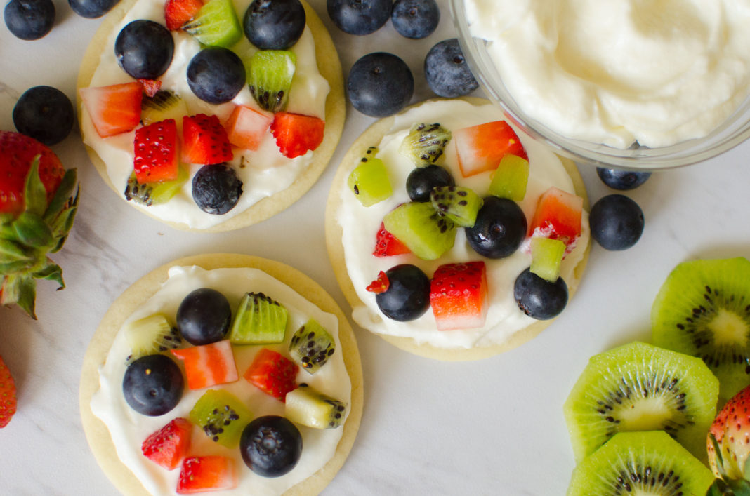 Sugar Cookie Fruit Pizzas made with an easy cookie base and topped with homemade frosting and chopped fresh fruit.