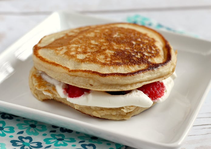 Pancake Breakfast Sandwiches are made with buttermilk pancakes, a delicious maple whipped cream filling and your favorite fresh fruit!