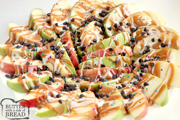 Caramel Apple Nachos are easily made by topping sliced apples with caramel, melted marshmallows, chocolate chips and sprinkles! This fun variation of a traditional caramel apple recipe is easier to share and easier to eat too!