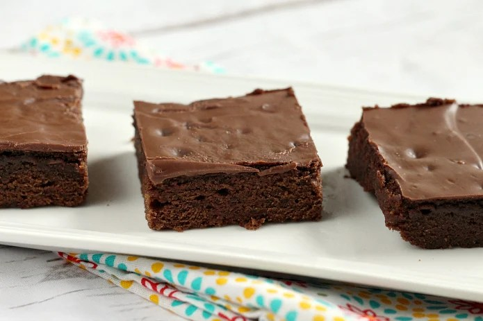 Easy Brownie Recipe with only 5 ingredients and then topped with Hershey bars for the easiest frosting ever! This chocolate dessert is a classic favorite and this is by far the easiest brownie recipe I've ever made without using a mix!