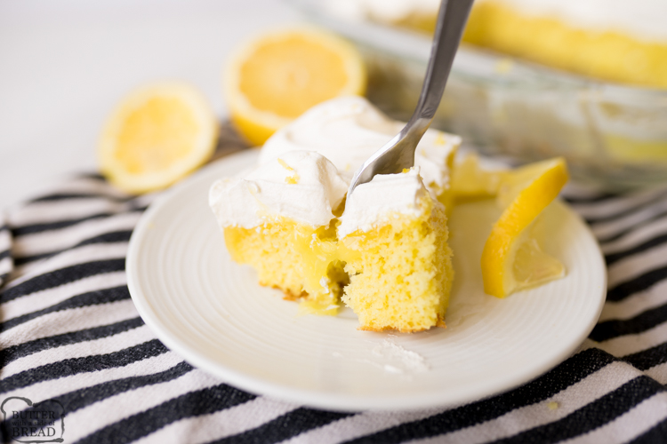 Lemon Poke cake, plated and being eaten with a fork.