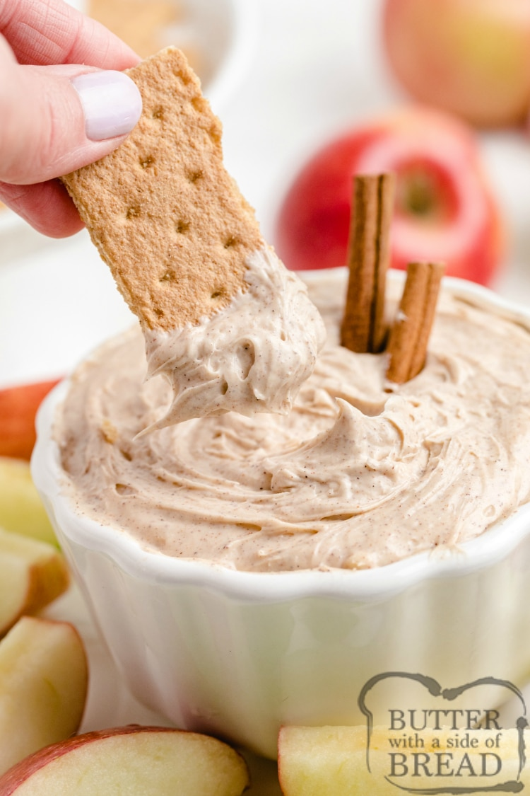 Dipping graham crackers in snickerdoodle cream cheese dip