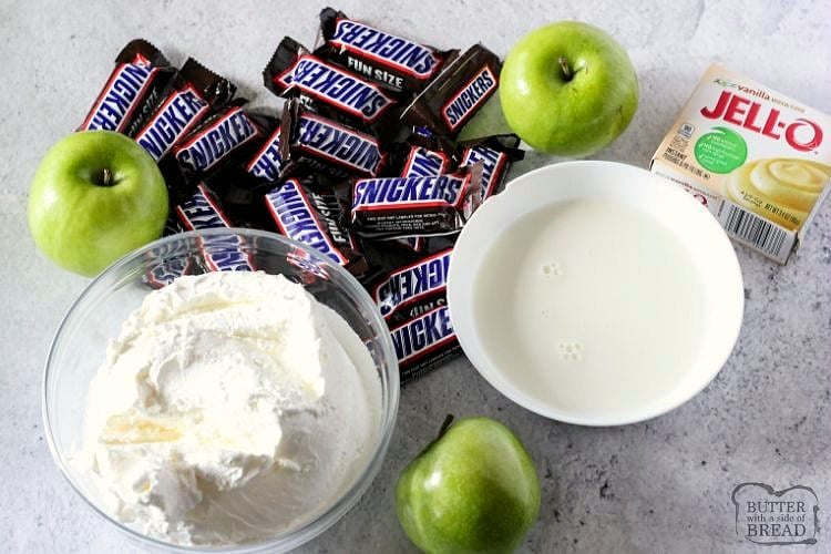 Ingredients for snickers salad. Cool whip, apples, pudding, milk and snickers