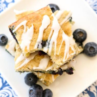 Glazed Blueberry Banana Bars are a simple & delicious ripe banana recipe that's even better than banana bread! Great for breakfast, lunch, snacking, and it even makes a great dessert!