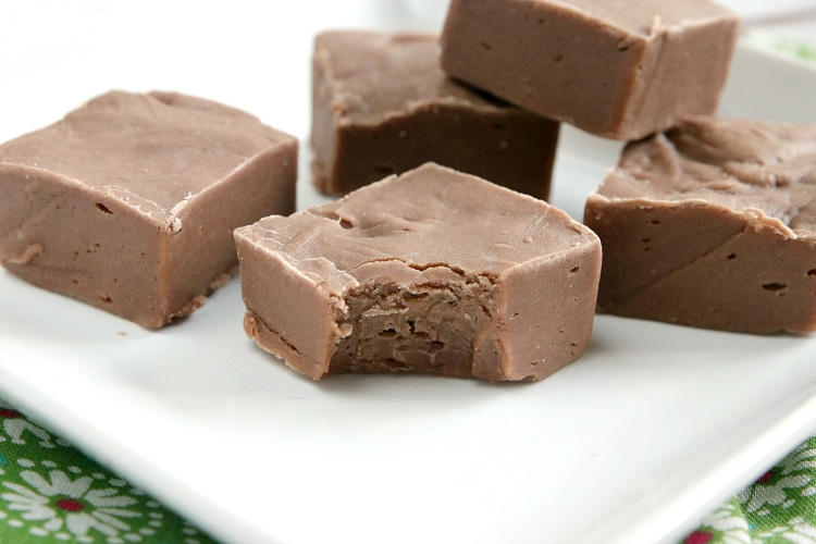 Easy Fudge recipe that is made with chocolate and vanilla pudding mixes, no candy thermometer necessary. This chocolate fudge recipe only requires six ingredients and only takes a few minutes to make. Delicious fudge recipe that turns out perfectly every time.