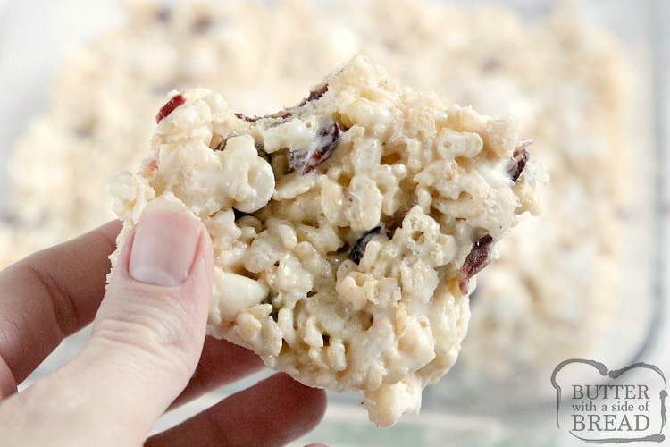 White Chocolate Cranberry Rice Krispie Treats are full of marshmallows, dried cranberries and white chocolate chips. This rice krispie treat recipe is topped with a simple, spiced vanilla glaze to make them even more delicious!