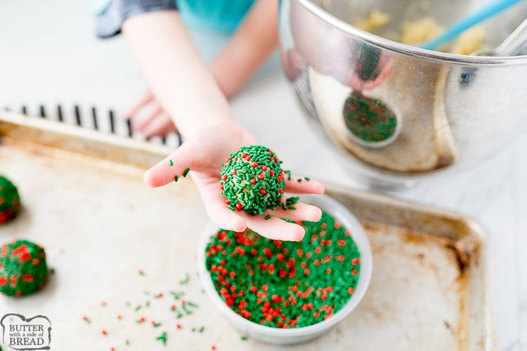sugar cookie dough covered in green and red sprinkles