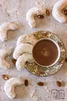 Almond cookies with a cup of hot chocolate