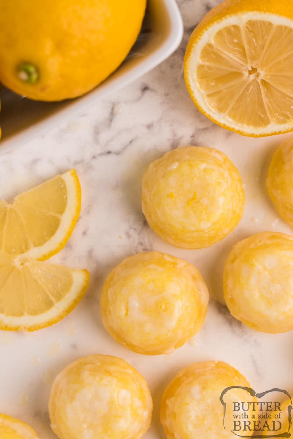 Mini Lemon Drop Cupcakes are delicious bite-sized treats that start with a lemon cake mix! The easy lemon glaze soaks into the inverted mini cupcakes and is a simple, incredibly delicious lemon cake mix recipe!