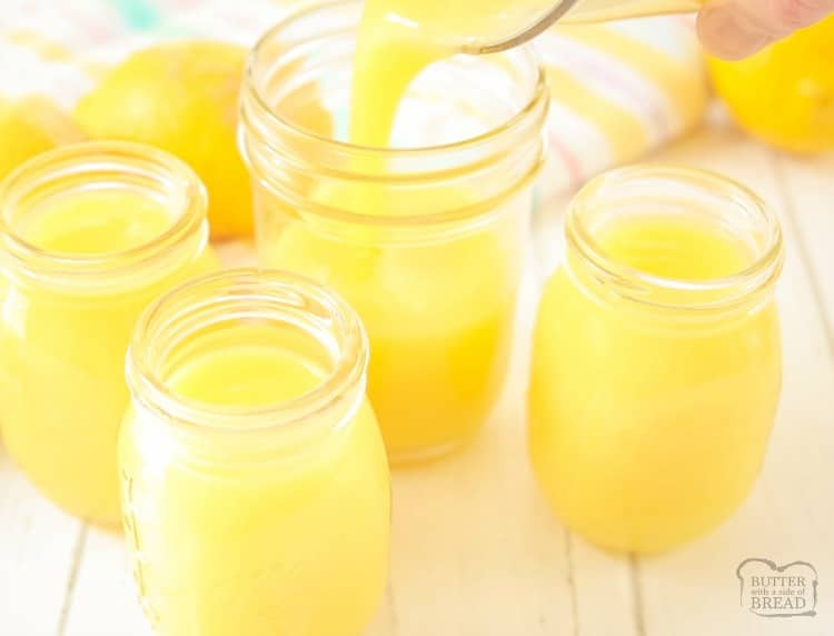 putting homemade lemon curd in glass jars