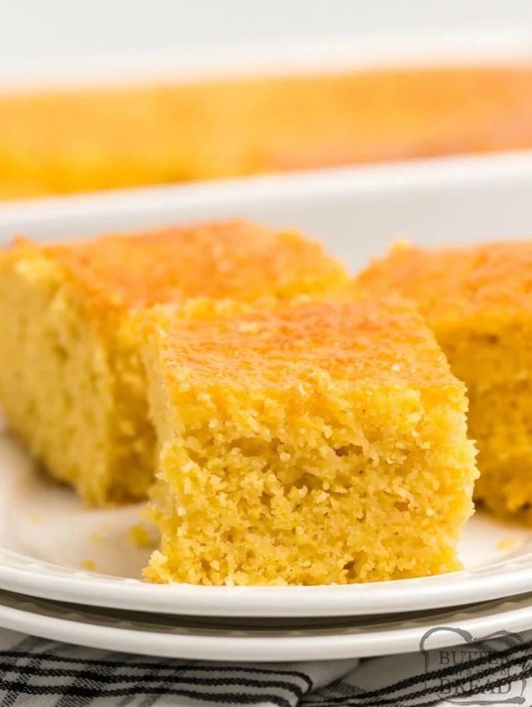 Homemade Cornbread recipe that is moist, slightly sweet and topped with a delicious honey butter. This easy cornbread recipe is made from scratch in one bowl with basic ingredients and it turns out perfectly every time.