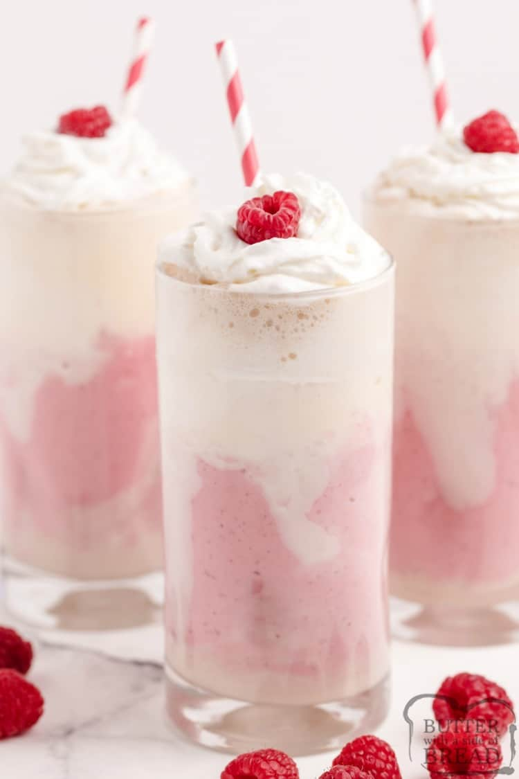 Raspberry Cheesecake Shakes are made with frozen raspberries, cream cheese, ice cream and cream soda. This easy milkshake recipe is so simple to make and is absolutely delicious, especially on really hot summer days!