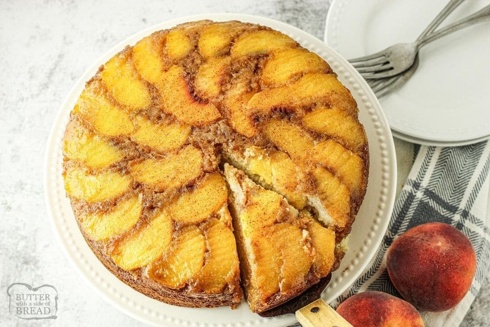 peach upside down cake with a slice being removed