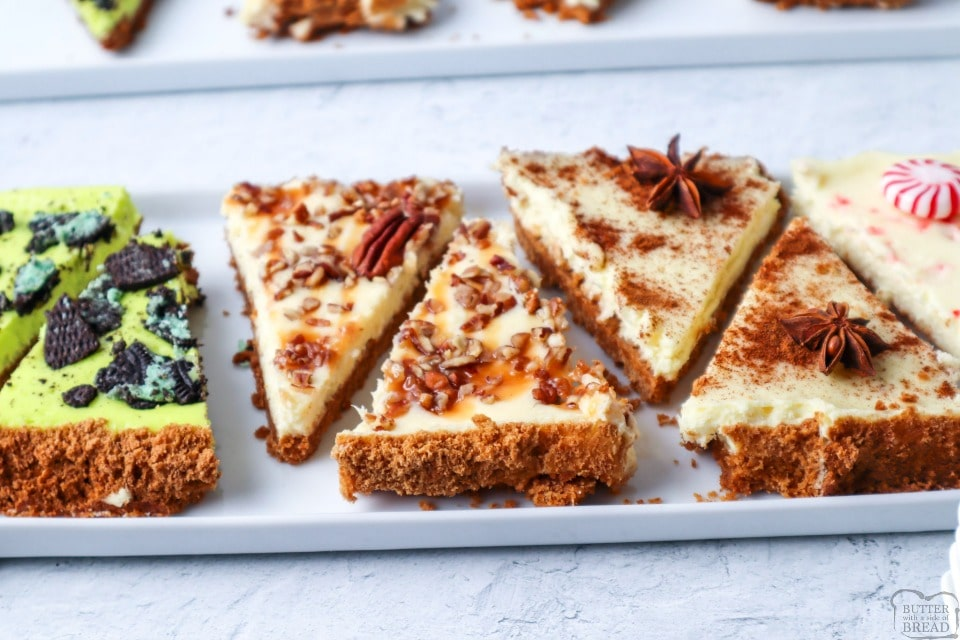 This easy sheet pan cheesecake recipe is one to remember. With just one simple graham cracker crust and a basic cheesecake batter we can create holiday cheesecake bars with 4 flavor options to choose from!   1 sheet pan and 4 delicious flavors of homemade cheesecake made conveniently on a sheet pan. Serve it up at your next holiday party and watch them disappear!