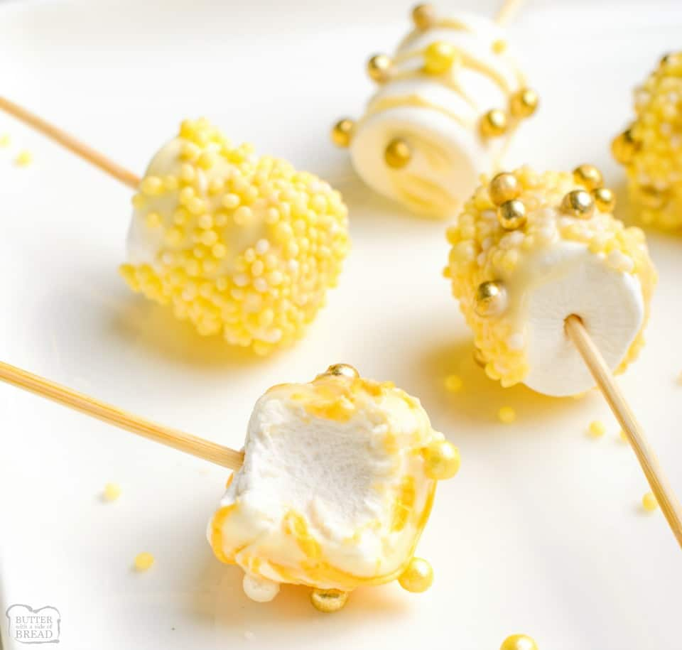 White Chocolate Covered Marshmallow Pops made with gold sprinkles for a simple, festive New Year's treat! Easy recipe for festive chocolate dipped marshmallows!