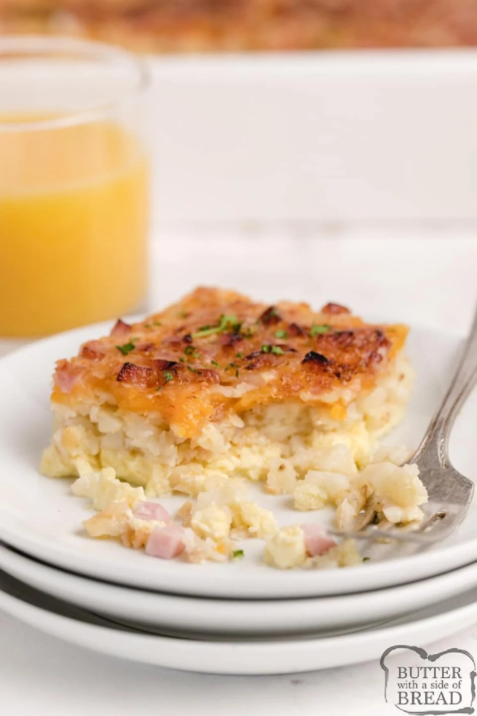 Hash Brown Breakfast Casserole made with a hash brown patty crust, ham, swiss cheese, cheddar cheese and eggs and milk. Only a few minutes of preparation for this easy breakfast casserole recipe!