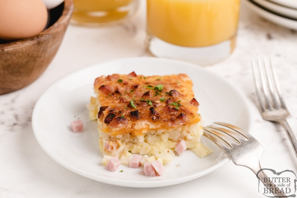 Breakfast casserole made with eggs, cheese, ham and a hash brown crust