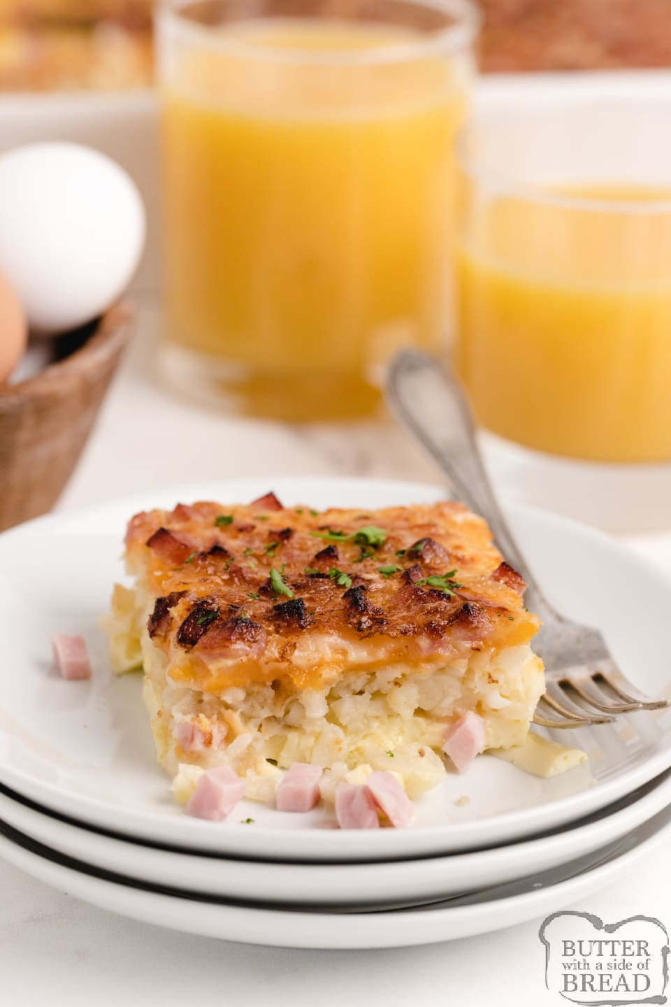 Breakfast casserole with eggs, cheese and ham with a hash brown crust