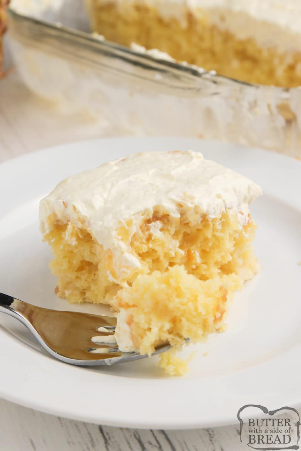 Pina Colada Poke Cake made with a cake mix, crushed pineapple and a delicious, creamy pina colada sauce. Easy poke cake recipe topped with a light, refreshing pineapple pudding topping.