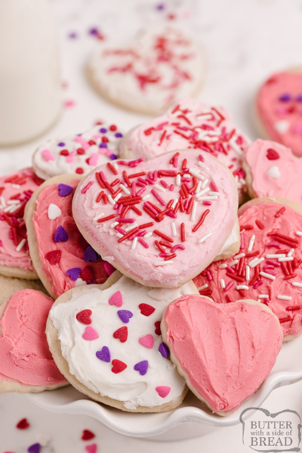 Valentines Sugar Cookiesare soft, thick and easily thebest sugar cookie recipe I've ever tried. These cream cheese sugar cookies are perfectly sweet and they hold their shape when baked!