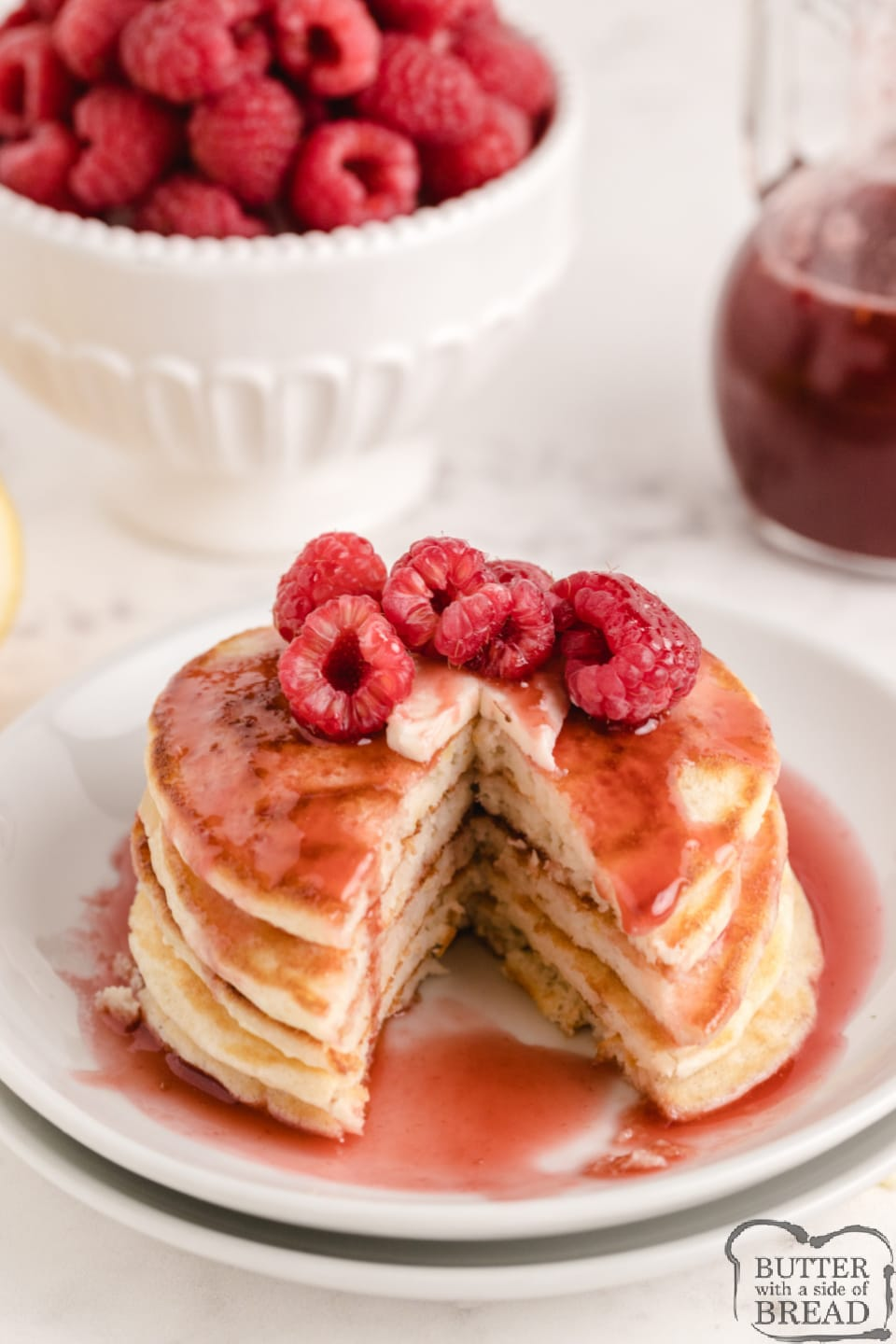 Lemon Pancakes with Raspberry Syrup are light and fluffy with a subtle lemon flavor. Top with a simple two-ingredient raspberry syrup made with frozen raspberries for a delicious pancake breakfast.
