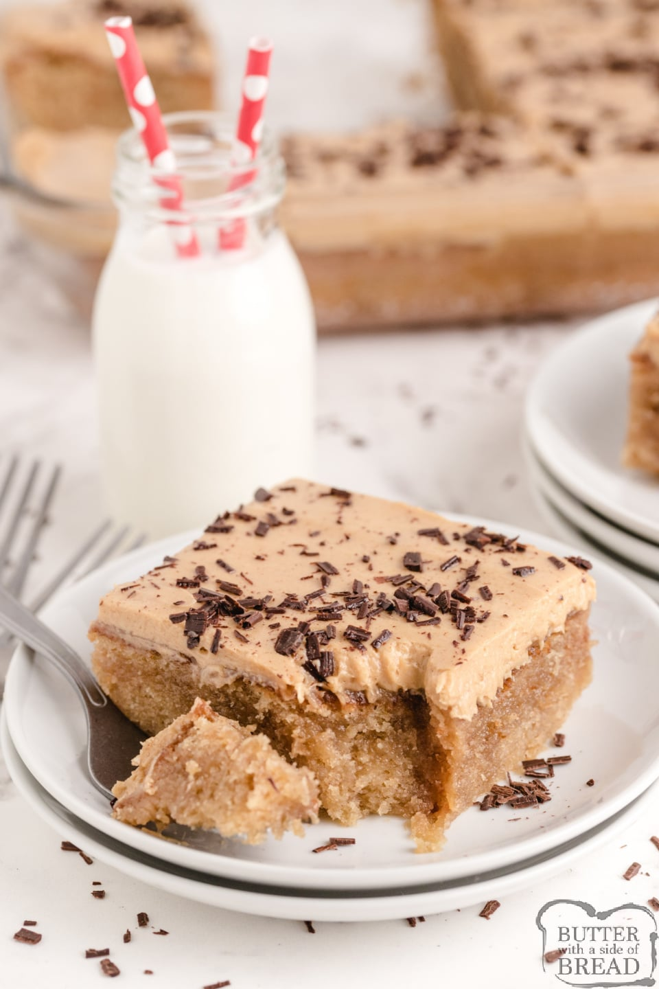 Peanut Butter Poke Cake made from scratch with a delicious peanut butter drizzle and a light peanut butter frosting on top! Tons of peanut butter flavor in this amazing poke cake recipe!