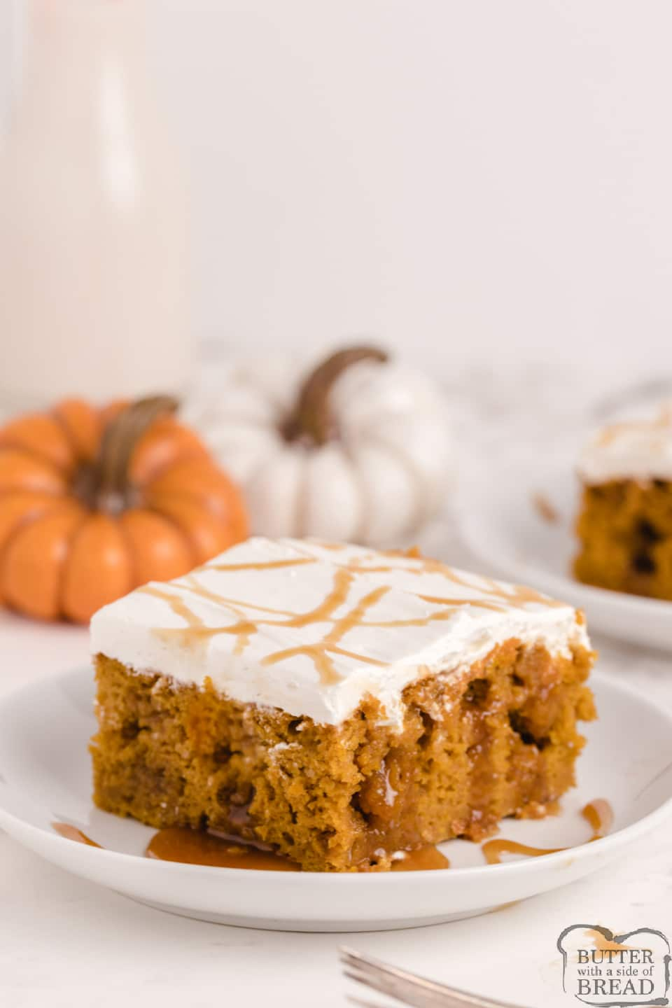 Caramel Pumpkin Poke Cake made with a cake mix, pumpkin, caramel and a simple cream frosting on top! Deliciously decadent poke cake recipe that is perfect for fall.
