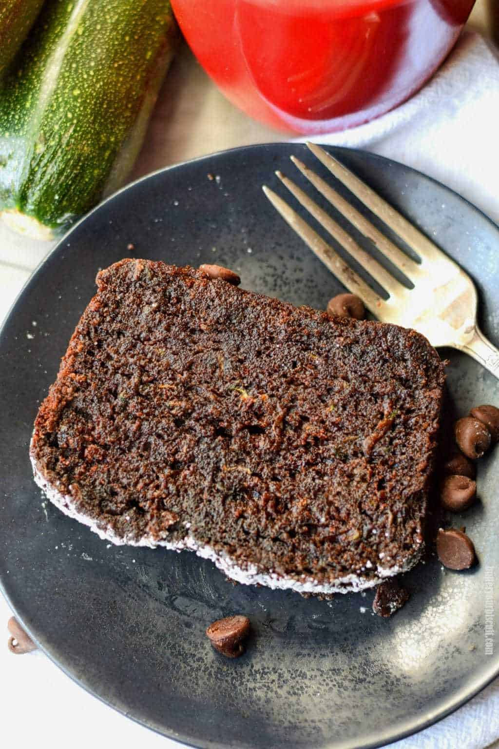 chocolate zucchini bread on a black plate with a fork