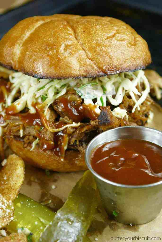 slow cooker pulled pork sandwich with chipotle slaw and chips