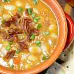 bean and bacon soup in a bowl with saltine crackers