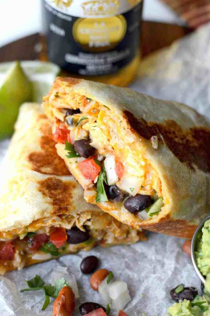 chicken burritos cut in half with a lime wedge