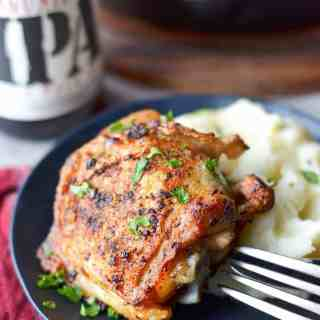 Crispy skillet chicken thighs served with mashed potatoes