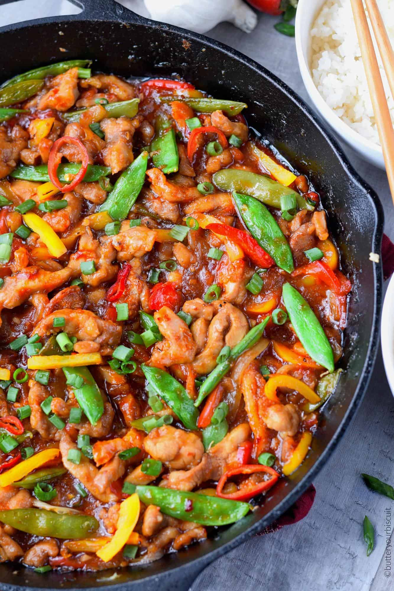 Sweet and Spicy chicken stir fry in cast iron skillet