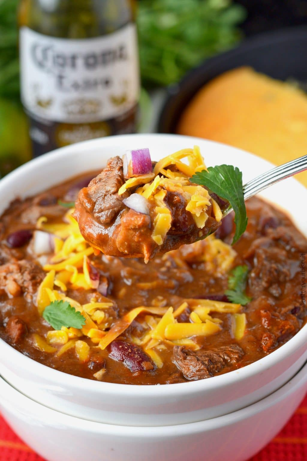 Ribeye steak chili in a white bowl with a spoon