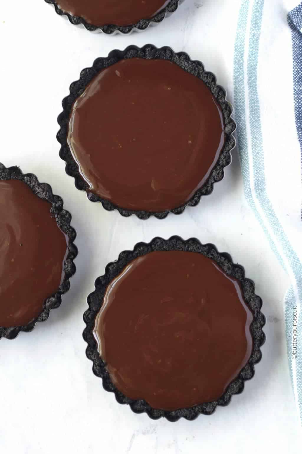 No bake chocolate mini tarts all set up and ready for fruit