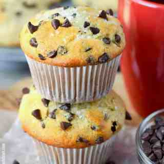 sour cream chocolate chip muffins stacked with a red coffee cup