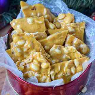 Microwave peanut brittle layered in a red gift tin
