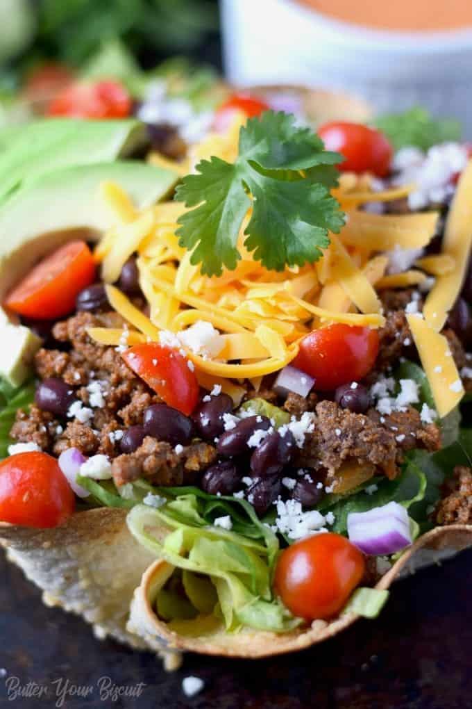 close up photo of taco salad in a tortilla bowl