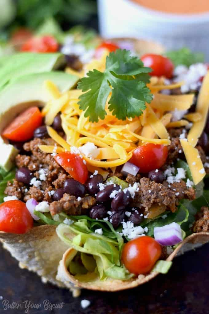 close up photo of taco salad in a tortilla bowl