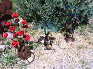 Metal roses & a metal peacock