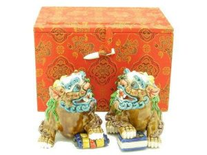 This is a pair of colorful Fu Dogs seen stepping on a scroll and a book for excellent knowledge, education, academic and scholastic luck!